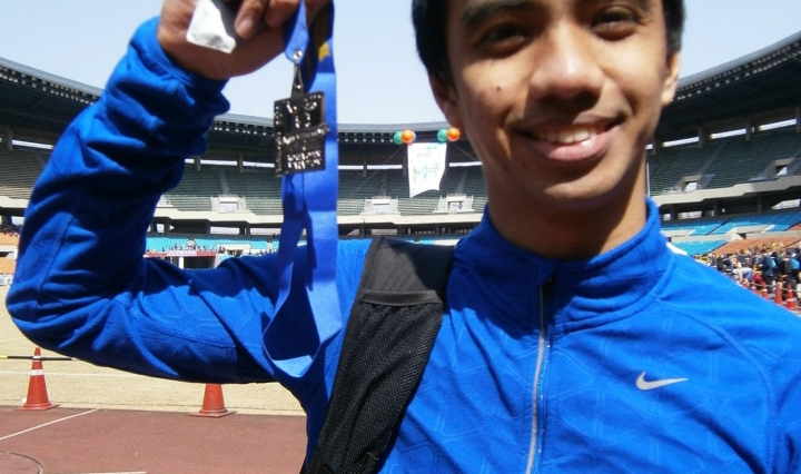 The Journeying Engineer holding a finisher's medal Korea