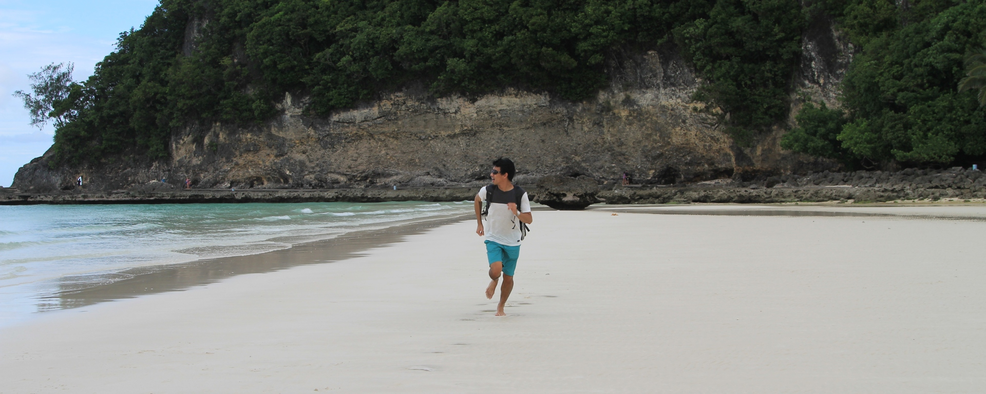 The Journeying Engineer running on Boracay beach