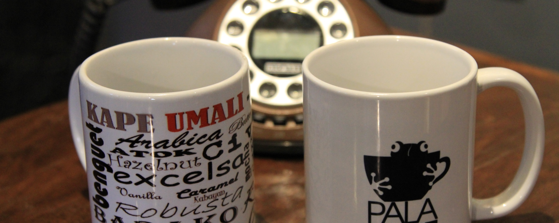 Kape Umali and Palakape mugs near vintage telephone