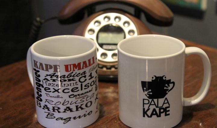 Kape Umali and Palakape mugs near vintage telephone