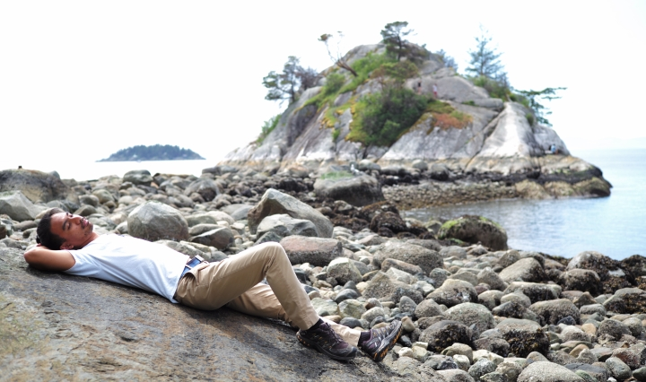 The Journeying Engineer lying on a rock